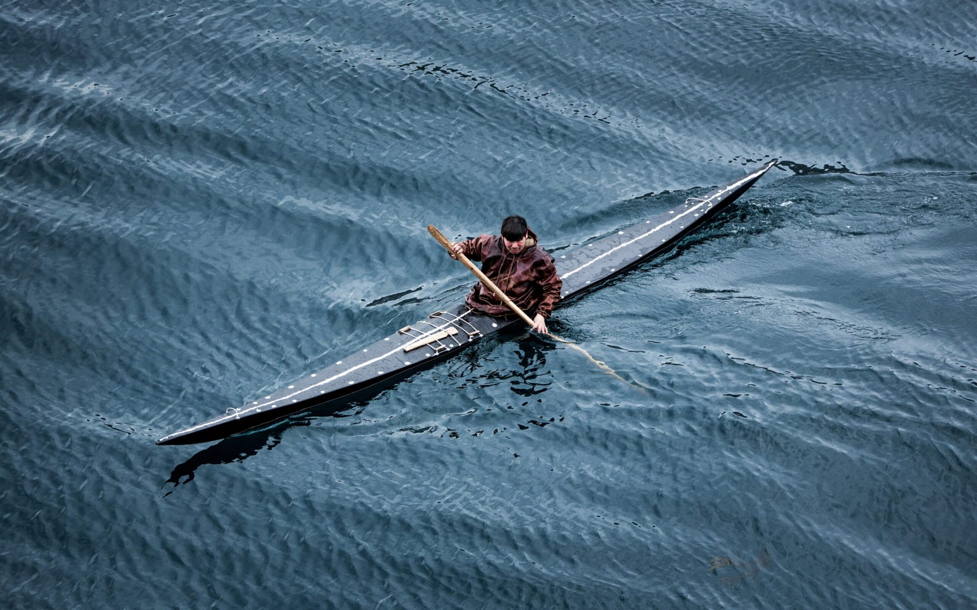 A kayaker from Sisimiut in Greenland in a traditional skin kayak-min