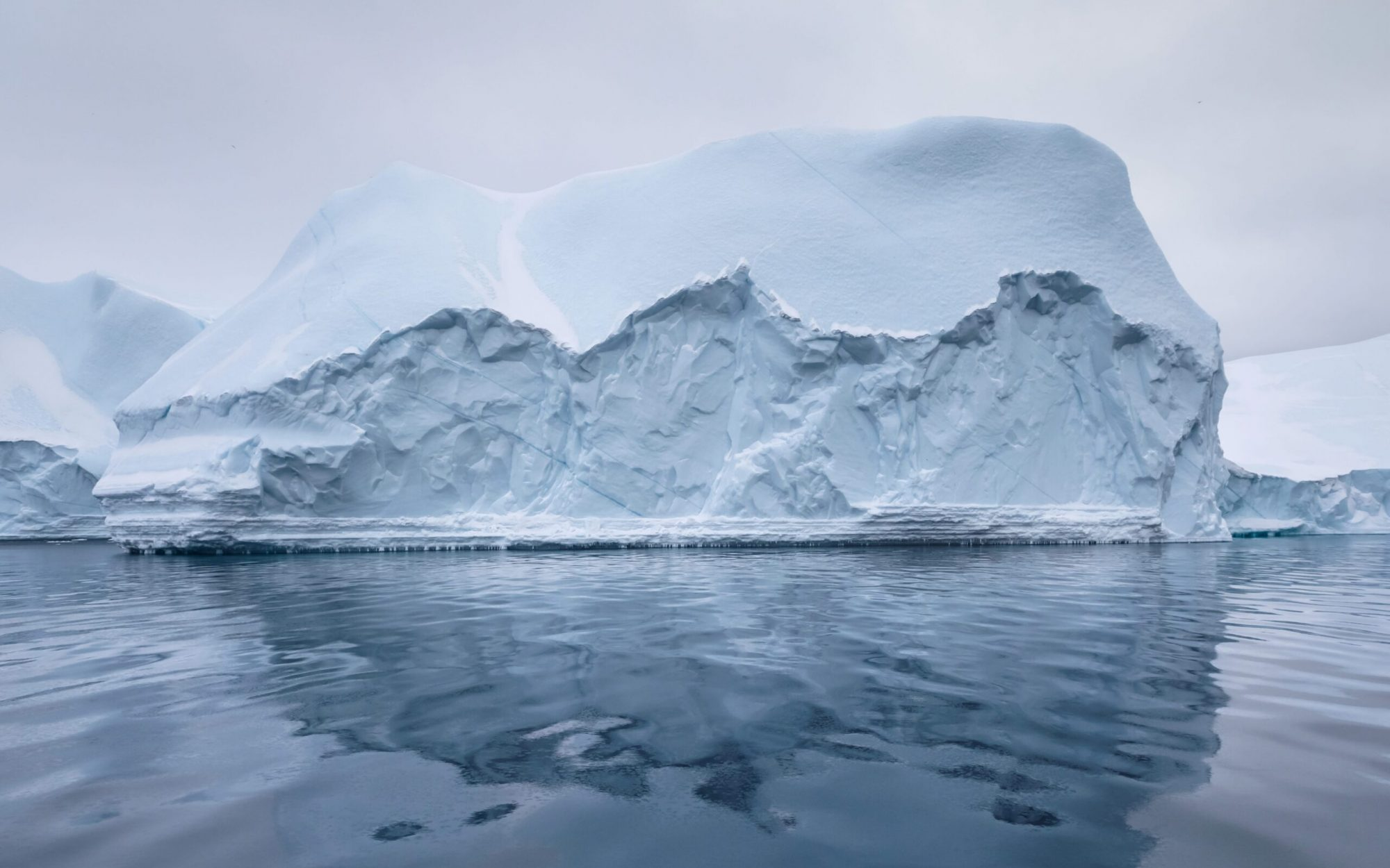 Iceberg under grey skies-min