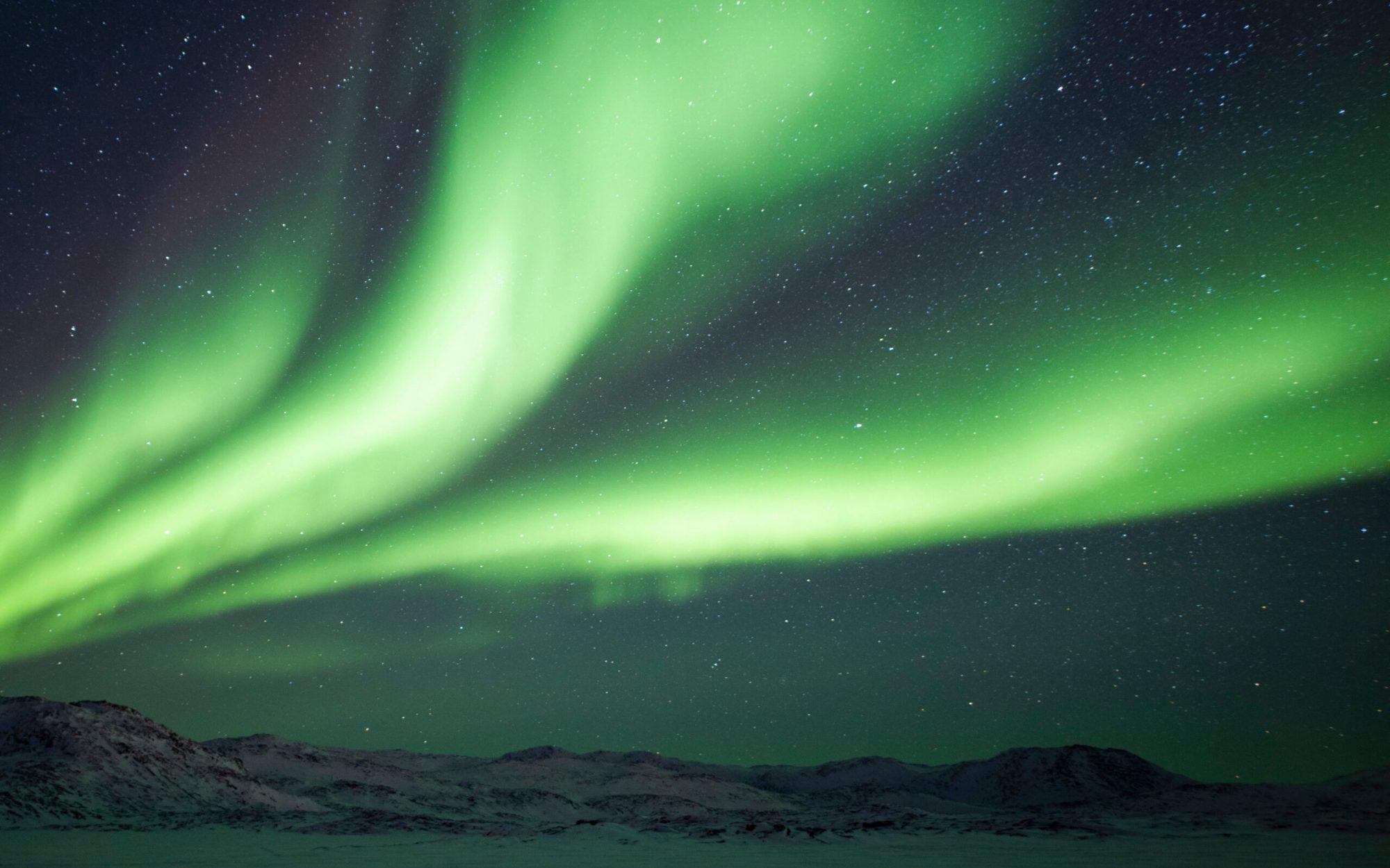 Northern Light at Ilulissat Icefjord. Photo - Aningaaq R. Carlsen, Visit Greenland-min